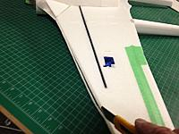 Name: 044.jpg Views: 23 Size: 93.8 KB Description: Trim excess from front and rear of wing then sand