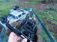 Name: DSCN5342.JPG Views: 461 Size: 1.16 MB Description: Massive amount of chassis flex. It would have been nice if they used a more rigid plastic for the chassis rails.