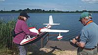 Name: 20180613_102723.jpg Views: 23 Size: 914.8 KB Description: Team Hardy getting the model onto the water. Just about the safest  - well clear of the props!