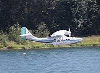 """Name: DSCF1139.JPG Views: 34 Size: 441.2 KB Description: 156. Ivan's Catalina 600, the100"""" span version with retracts on UC and floats. Built in 1999 and flown here by a new owner at the Skway Lake club venue."""