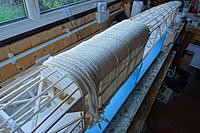 Name: 42.JPG Views: 26 Size: 1.76 MB Description: The first of the shaped and dried sheeted sections being glued in place. The soft bandage does not mark the sheet like pins or clamps