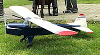 Name: Ron's Auster.jpg Views: 8 Size: 1.27 MB Description: 179. Ron Dodd's Auster on its re-maiden after a good few years on the shelf, and after being recovered from the scrap bin at the old field and completely rebuilt. This flight was in May 2021.