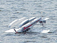 Name: 2012_02250008.jpg Views: 82 Size: 161.2 KB Description: ...the wind picked up to about 14 kts and flipped Adrian's Fun Cub on landing, fortunately without any damage.