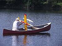 Name: DSCF3010.JPG Views: 103 Size: 893.2 KB Description: His canoe, his plane...whose fingers on the sticks?