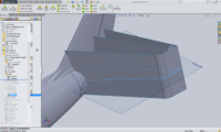 extruded surface past the horizontal stab ref plane, and an intersection curve generated on that plane. Some construction lines were added to aid created on additional reference planes to draw the root and tip airfoils.