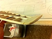 Name: shaped wingtip front.jpg Views: 534 Size: 69.1 KB Description: This is my first stab at a scale formed wingtip (which will also add some function to prevent tip stalls).  I was inspired by the E-Flite Cessna 150 ARF.  I used soft balsa and sanded it to shape.  Then I drenched it with thin CA to harden it up for those