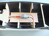 Name: Hellen-Drive Unit in Situ.JPG Views: 162 Size: 89.0 KB Description: Here you can see that the motor tray and motor has now been mounted and attached to the drive shaft. I've drilled a few holes in the frame to route wiring. The servo tray is also in position.