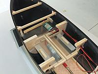 Name: Hellen-Electronics Tray.JPG Views: 168 Size: 98.1 KB Description: I put holes in the frame pieces to route the wiring.  The removable Lexan trays for the batteries and the electronics shelf can also be seen.
