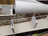 Name: SAM_3001.JPG Views: 7 Size: 3.52 MB Description: The jig 'uprights'  bear against the upper longeron to keep everything in alignment. At the bottom, equal width spacers keep everything 'plumb'. The vertical taper is controlled by the two 'decks' that fit between the fuselage sides.