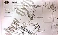 Name: IMAG0065.jpg Views: 338 Size: 108.8 KB Description: Step 8 sayings to install servo and route your wires through the wing. Notice on the picture how the Clamshell is not glued to the wing yet.