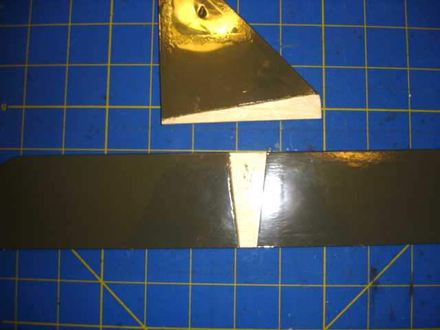 Name: SE5a 020.jpg Views: 983 Size: 23.1 KB Description: The covering removed from the stabilizers to allow the wood to be glued to the fuselage.