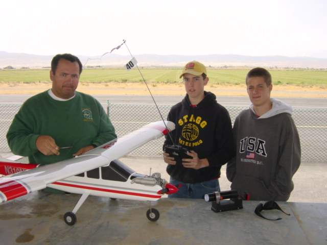 Name: mountingwing.jpg Views: 1,889 Size: 28.7 KB Description: Here is instructor, Jeff Hunter mounting the wing with a plastic bolt into the flex mount system in the fuselage. To his left are scouts Andy and Ross.