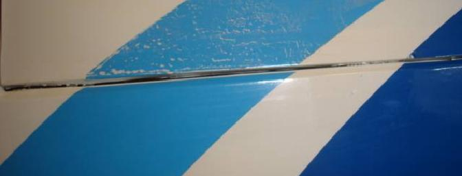 This picture shows the white added to the blue when it pulled away from the covering while removing tape.