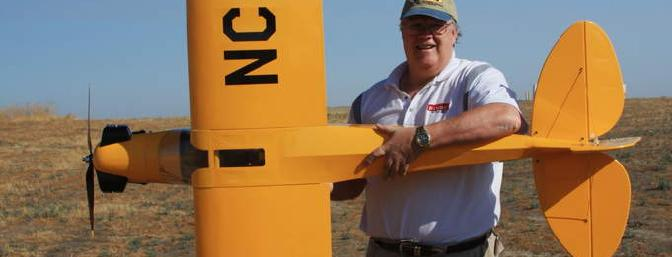 Author with plane at Los Banos on July19.
