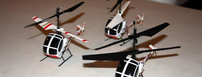 Two Blade mCX S300 ultra-micro Schweizer helicopters and one original mCX with conversion except for original landing skids.