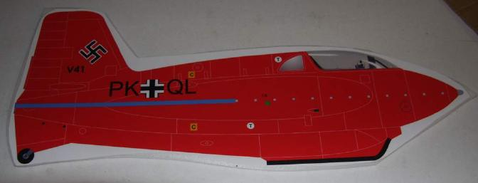 The right side applied and applique and foam trimmed along the outer edge of the plane's profile.