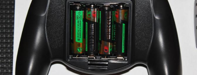 The 4-included AA Alkaline batteries installed in the back of the transmitter.