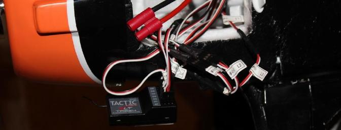 The wires are long enough to attach them to the receiver outside of the battery bay.