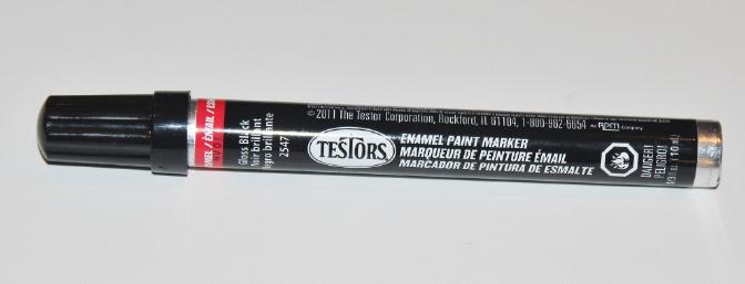 This Testor's black paint pen does a wonderful job with touch-ups on the black bottom of the