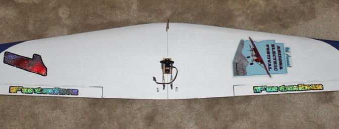 The assembled wing with servo mount and servo installed and connected with vinyl decals installed.