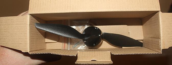 The propeller, spinner and two tail mounting bolts came in this box for safe travel.