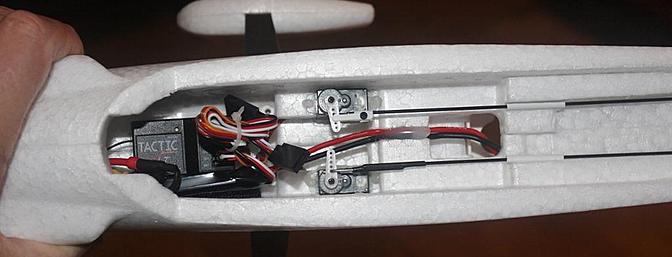 The SLT receiver came installed in the fuselage and connected to the ESC, the rudder and elevator servos and with an installed Y-harness for the ailerons. Note where the control rods came installed.