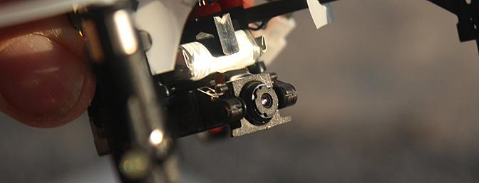 The camera mounted under the 1SQ V-Cam takes both video and still pictures.