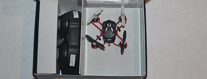 Inside the box we see the Proto X, its transmitter and a box with the spare rotors and the charging cord.