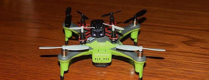 The Proto X on top of the 1Si Heli-Max quadcopter.