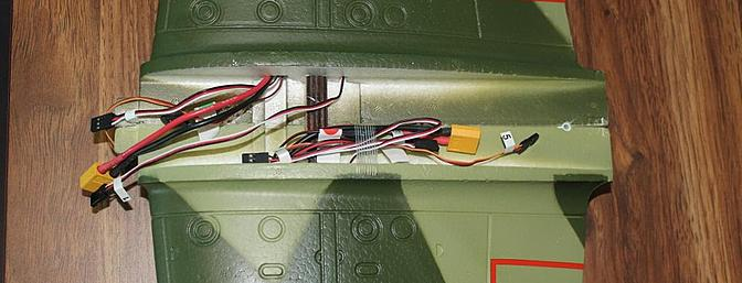 A total of 11 wires for the wing means a crowded fuselage in the wing saddle area of the plane.