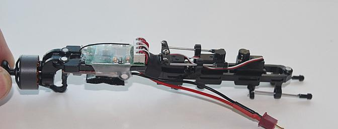 Here the power core is upside down. The two circles top left secure the core to the front of the frame. The one on the right to the back bottom of the frame.