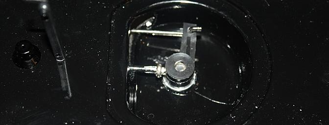 The rudder control connection and mount is just under the deck area in a recessed area.