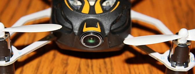 The camera lens is mounted on the front of the Proto X FPV.