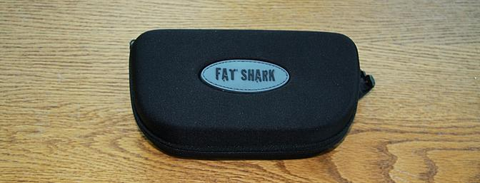 The included protective case for the Fat Shark goggles, antenna, cleaning cloth and its battery.