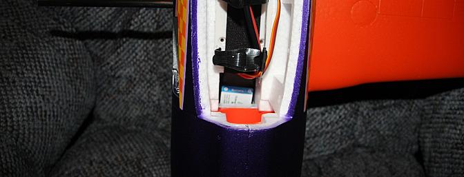 One wing half slid into place with the aileron servo wire in the fuselage but not yet connected.