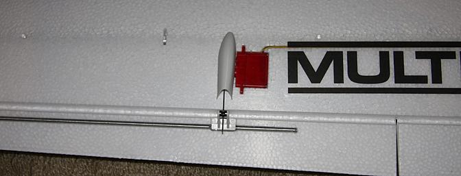 The aileron servo and the metal rod stiffening the aileron.