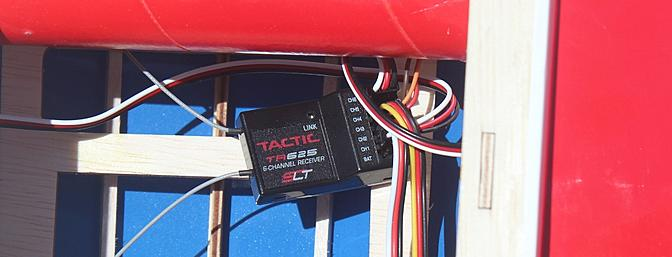 The Tactic six channel receiver installed behind the wing rod in the fuselage.