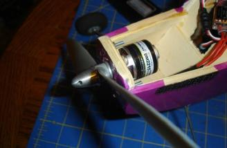 The Velcro epoxied in place on both sides and the motor firmly mounted in place with prop adaptor and prop installed.