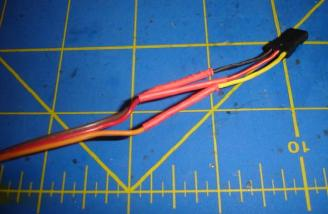 The wires have been twisted together, covered in Flux, soldered together with the heat shrink tubing over the connection. The final step is taping the wires together for strength and to avoid one getting snagged.