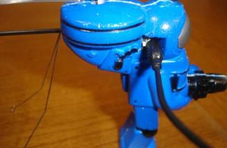 This close up shows the charging jack attached to the blue Marine. The On/Off switch is just to the left of the charging jack.
