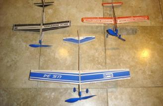 The rubber band powered planes being reviewed.