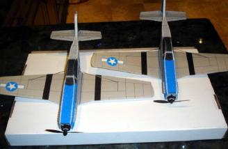 In both pictures the one on the left has the recommended dihedral and flew fine.