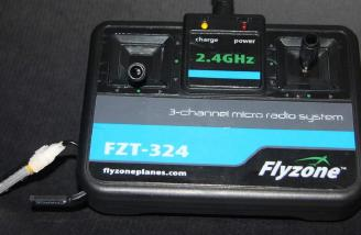 The flight battery charges from the transmitter as shown in this picture.