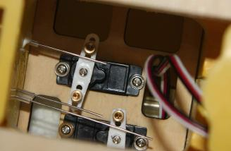 The control wires in the servo compartment after installing the tail components to the fuselage.