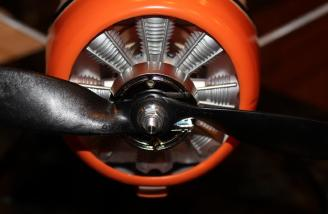 The propeller and back spinner plate were secured to the propeller shaft with a nut securely tightened.