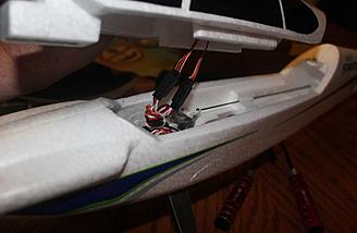 The aileron servo wires are connected to the Y-harness that came installed into the receiver.