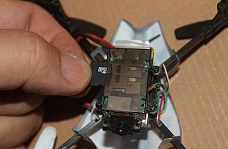 Inserting the memory card into the 1SQ V-cam.