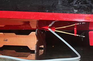 A picture of the tubing connected to the pump. The pump intake which faces the stern.