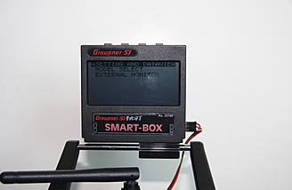 The Smart Box mounted to the handle of the m-12 with two screws clamping the base onto the bar