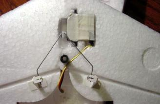 Hitec 85 servo mounted in the bottom of the canard and connected to the elevators with included hardware.